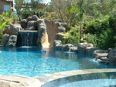 waterfall and slide for pool | Pool landscaping, Backyard